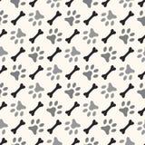 Seamless animal pattern of paw footprint and bone Stock Image