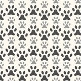Seamless animal pattern of paw footprint Stock Photos