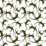 Seamless animal vector pattern, chaotic background with dark reptiles, silhouettes over white backdrop. Royalty Free Stock Photos