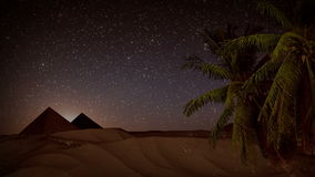 Seamless animation desert sand storm at night with palm trees, shining stars, and pyramids background landscape. With sand hills desert in 4k ultra HD stock video footage