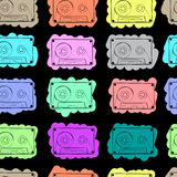 Seamless audio cassettes color. Seamless texture with multi-colored vintage audio cassettes Royalty Free Stock Photography