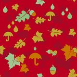 Seamless autumn background with leaves and umbrellas. Royalty Free Stock Photos