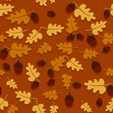 Seamless autumn background with oak leaves and acorns. Stock Photography