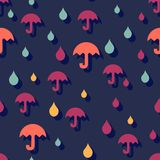 Seamless autumn background with umbrellas and rain. Stock Image
