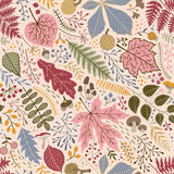 Seamless autumn pattern of leaves, branches and berries Stock Image