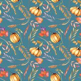 Seamless autumn pattern with watercolor pumpkins, tree branches and berries. Hand painted on a dark blue background Royalty Free Stock Photography