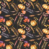 Seamless autumn pattern with watercolor pumpkins, tree branches and berries Royalty Free Stock Images