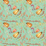 Seamless autumn pattern with watercolor pumpkins, tree branches, rowan and other berries Royalty Free Stock Photo