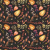 Seamless autumn pattern with watercolor pumpkins, tree branches, rowan and other berries Stock Images