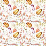 Seamless autumn pattern with watercolor pumpkins, tree branches, rowan and other berries. Hand painted on a white background Stock Photography
