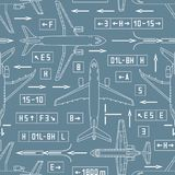 Seamless aviation pattern with airplanes and signs on a gray bac Stock Image