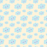 Seamless baby pattern with cute blue smiling clouds on pastel yellow background,  illustration, eps 10. Kawaii smiling cloud Royalty Free Stock Image