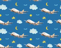 Seamless baby pattern with flying planes,clouds, moons, stars in night sky in watercolor style stock photos