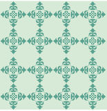 Seamless background. Ornament of green colour on a pale-green background Stock Photos