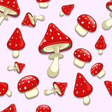 Seamless background amanita toxic mushrooms Stock Images