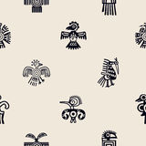Seamless background with American Indians relics dingbats characters. For your design Stock Photos