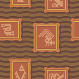 Seamless background with American Indians relics dingbats characters Royalty Free Stock Photography