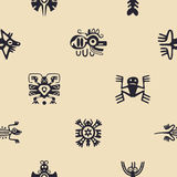 Seamless background with American Indians relics dingbats characters. For your designn Stock Photography