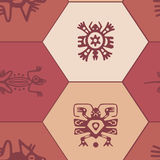 Seamless background with American Indians relics dingbats characters Stock Photos