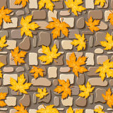 Seamless background with autumn leaves on paving s. Seamless texture of beige and brown stone wall stock illustration