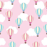 Seamless background of baby shower illustration with cute pink and blue hot air balloon on pink sky suitable for baby wallpaper, p Stock Image