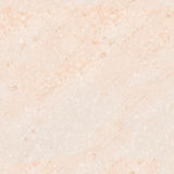 Seamless background from Beige marble tileable texture by over-size Stock Photography