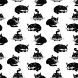 Seamless background of the black cats. Vector pattern of the cartoon black cats Royalty Free Stock Photo