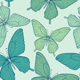 Seamless background with blue butterflies. Stock Photography