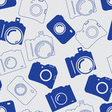 Seamless background with blue cameras. Seamless background with blue professional silhouette of cameras Stock Photos