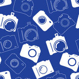 Seamless background with blue cameras. Seamless background with blue professional silhouette of cameras Stock Image