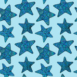 Seamless background with blue doodle star. Stock Photography