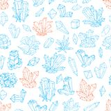 Seamless background with blue and orange doodle crystals on white background.  Royalty Free Stock Photo