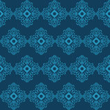 Seamless background with blue ornament on dark background Royalty Free Stock Photos