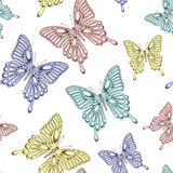 Seamless background with bright colorful butterflies. Beautiful seamless background with bright colorful butterflies . Hand-drawn contour lines and strokes Royalty Free Stock Photos