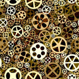 Seamless background of bronze gears wheels. Royalty Free Stock Photos