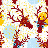 Seamless background with brown deer on an orange light blue background. New Year. Winter.  Stock Photography