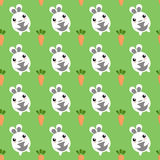 Seamless background of bunnies and carrots Stock Photos