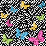 Seamless background. butterflies on animal zebra abstract print.� Royalty Free Stock Photos