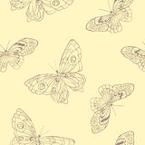 Seamless background with butterflies on beige background Royalty Free Stock Image