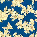 Seamless background with butterflies and blossom apricot on blue Stock Photography