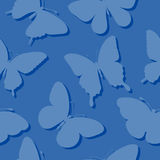 Seamless background with butterflies silhouettes in blue colors. Royalty Free Stock Photography