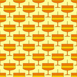 Seamless background with cakes. Seamless background with repeating cake with one candle isolated on yellow background Royalty Free Stock Photos
