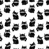 Pattern of the domestic black cats. Seamless background of the cartoon black cats Royalty Free Stock Photography