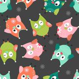 Seamless background with cartoon owl. Seamless pattern with funny multicolored owls on a dark background for children. Vector illustration Stock Photography