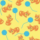 Seamless background with cats and clews. On yellow Stock Photos