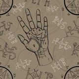 Seamless background with chiromancy symbols and human hand with lines Royalty Free Stock Photo