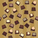 Seamless background with chocolate candies. On brown Stock Image