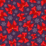 Seamless background of Christmas bows and snowflakes. Pattern Stock Photos