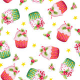 Seamless background with Christmas cupcakes in watercolor. Seamless pattern with watercolor Christmas cupcakes and holy berry on a white background Stock Images
