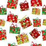 Seamless background with Christmas gift boxes. Over white background stock illustration